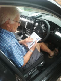 Derek with manual for new car